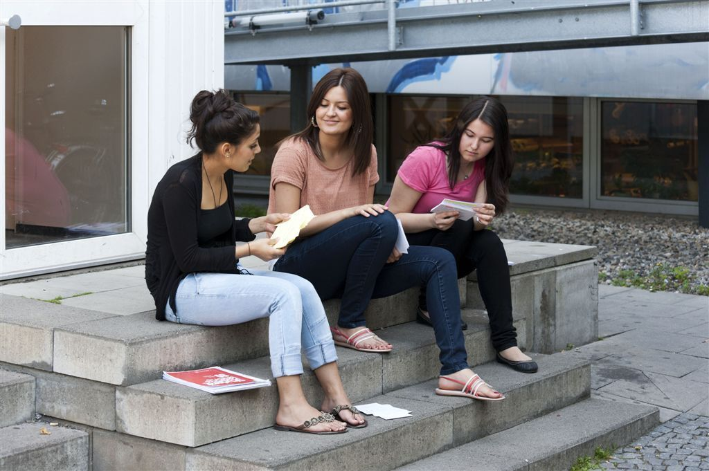 Female students in front of the library